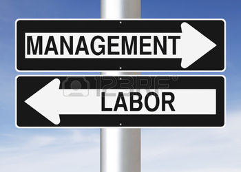 41614421-modified-one-way-signs-indicating-management-and-labor